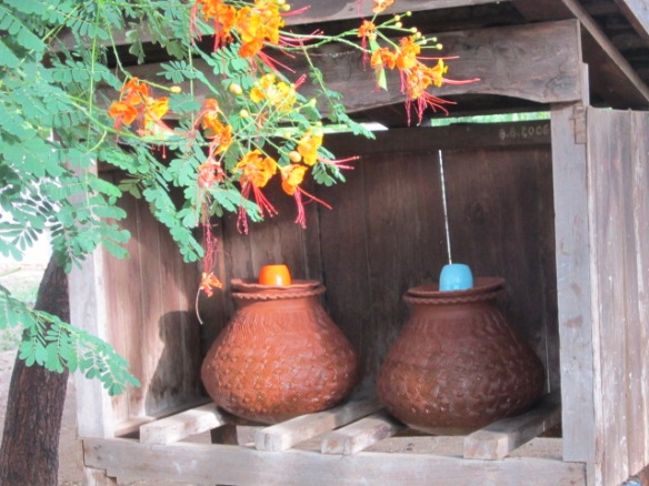 These clay pots are filled with drinking water that is available to all passersby.