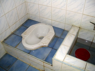 Typical Thai squat toilet - photo from: http://www.learnthaiculture.com/thai_culture_thai_toilet.shtml