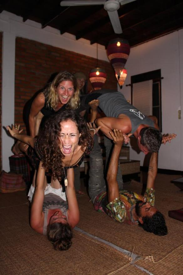 Acroyoga in my living room with Emily, Zahara, Neko, and Vari.