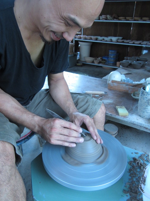 My outstanding ceramics teacher Jern, showing me trimming techniques.