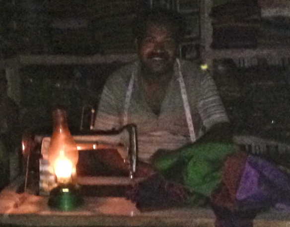 This tailor, Anthony, finished sewing our silk items by candlelight...and with a smile
