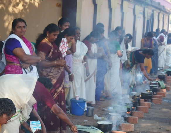 Hundreds of women preparing rice and masala spices for the puja.