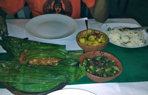 One of our best meals in Kerala - Fish with Kerala spices cooked in banana leaf, veg. curry, and fried okra.
