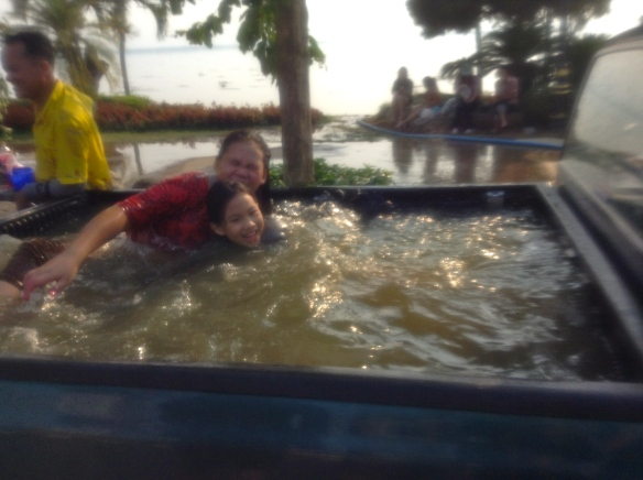 Riding in the back of a truck/swimming pool