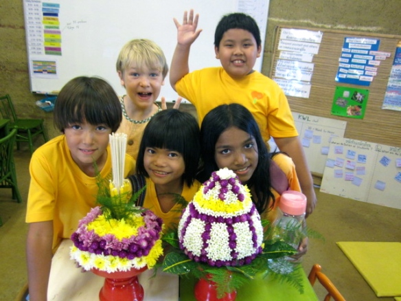 Students with their wai kru flower arrangements they made.