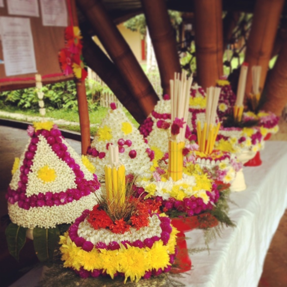 An assortment of wai kru flowers on phan พาน made by the students.