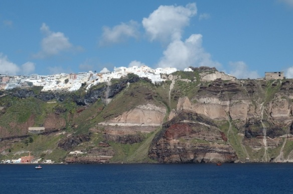 From the ferry, when the cliffs of Santorini come into view, the whitewashed buildings appear like snow on a mountain top.