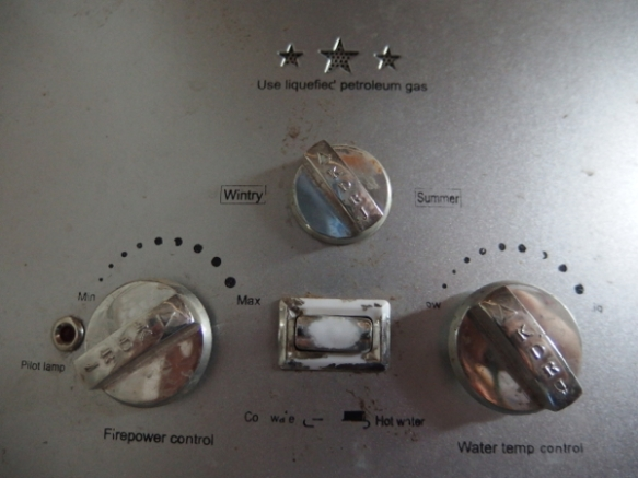 Noticing the 'Wintry' and 'Summer' settings on the hot water heater for a shower